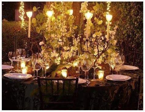 The table decorations: lots of white flowers, branches and