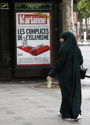 In this Thursday, May 21, 2015 photo a Muslim woman …
