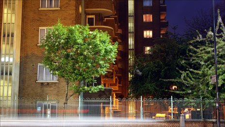 Arty picture of trees outside urban buildings