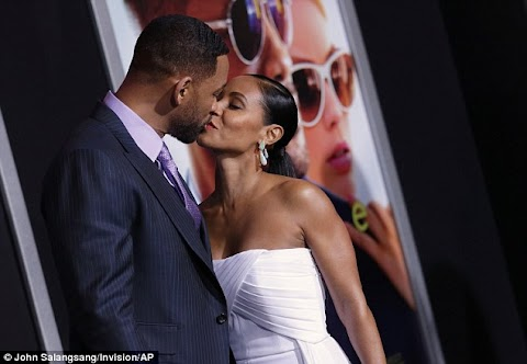 Will Smith passionately kisses his wife of 18 years Jada Pinkett at the red carpet premiere for Focus.