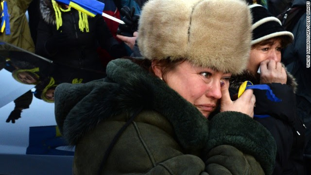 A woman cries during a rally on November 30.