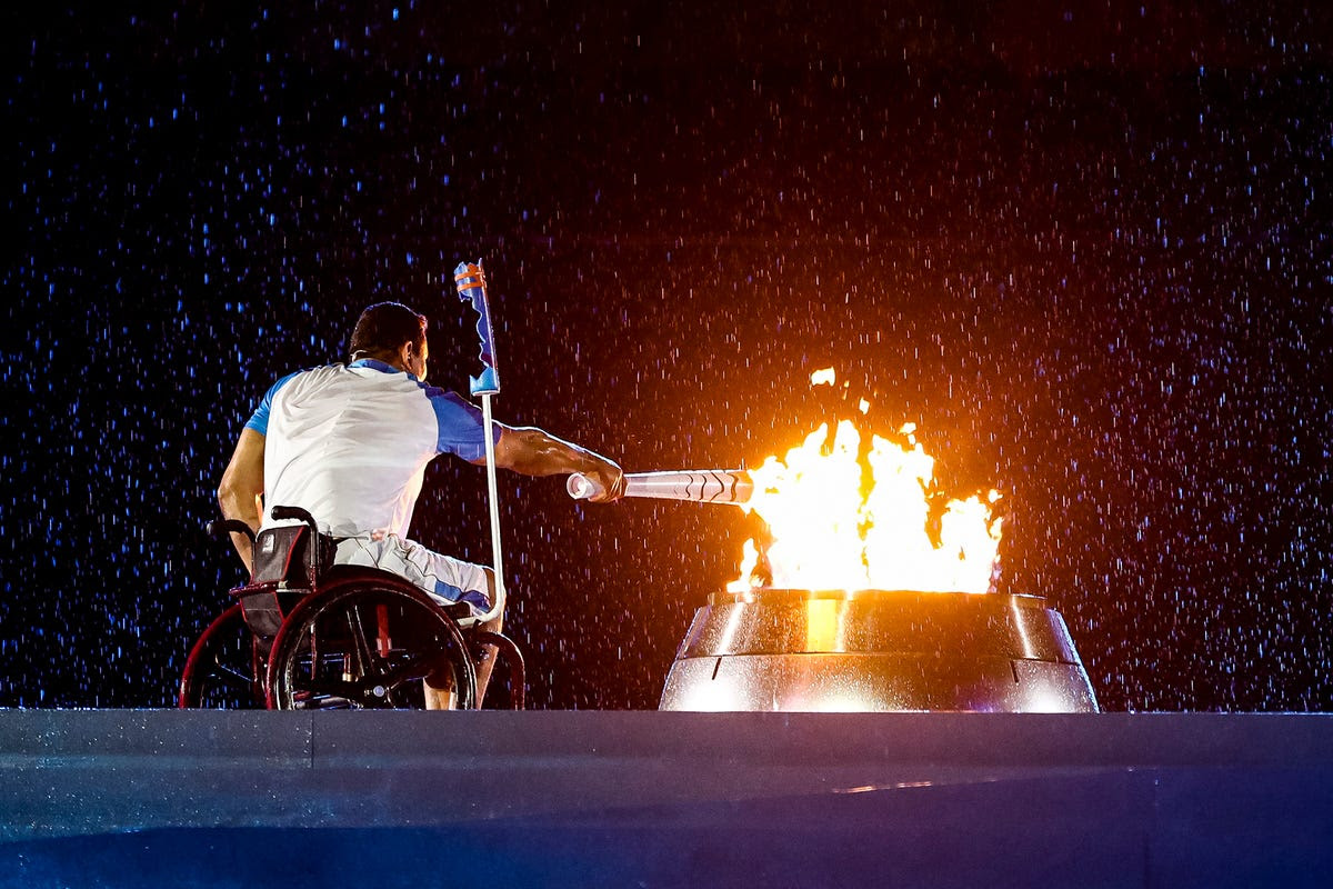 Brazilian swimmer Clodoaldo Silva lights the cauldron during the Opening Ceremony