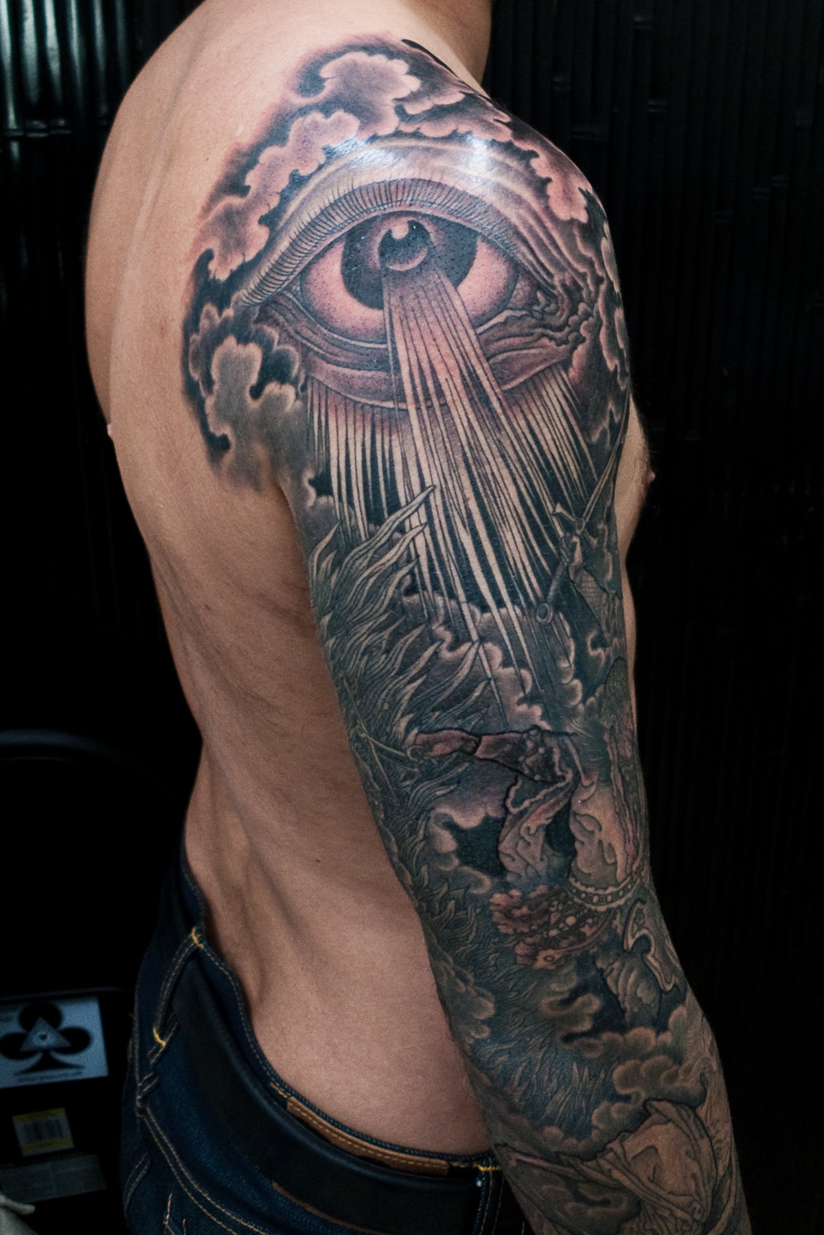 Grey Ink Eye And Tree Sleeve Tattoo