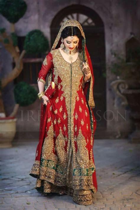 Pakistani bridal wear . Red dress , long dress. Pakistani