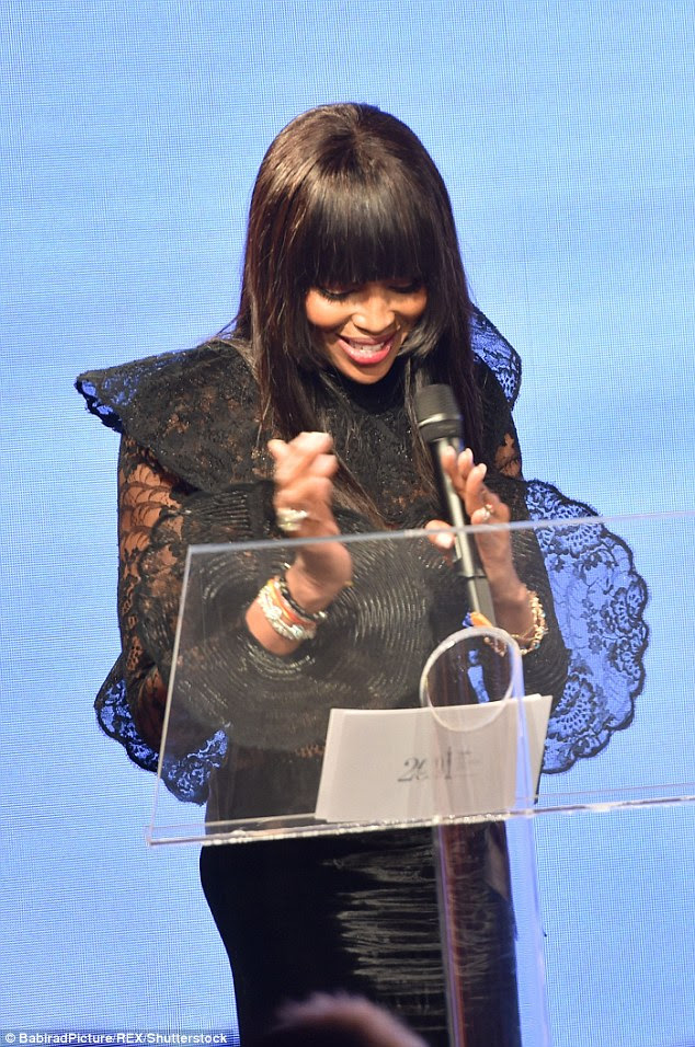 Honoured: Naomi looked delighted as she gave her acceptance speech