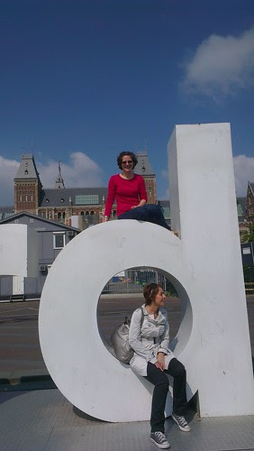 Liz sits on the letter D