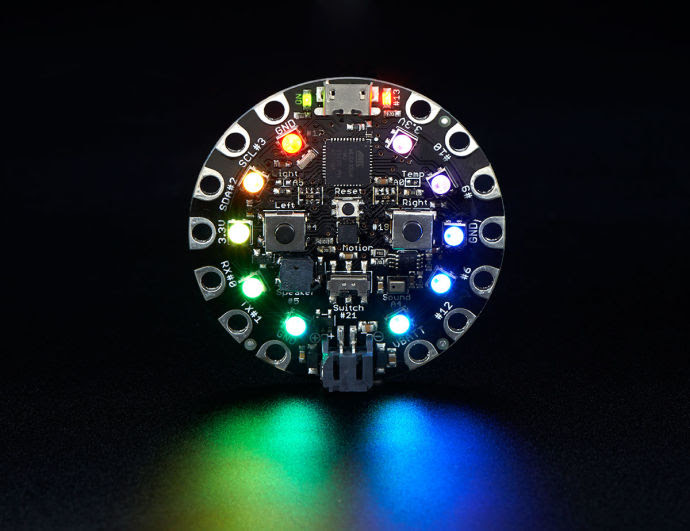 """Limor Fried describes the Circuit Playground as """"the Happy Meal of electronics—everything you could possibly want and a toy, too."""" Her goal was to squeeze all of her company's most popular pieces of hardware, including L.E.D.s, a range of sensors, and """"a really annoying beeper,"""" onto a single affordable device."""