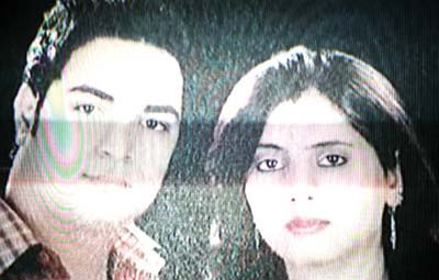 "A TV grab of Kuldeep Singh and his wife Monica (Ankit Chaudhury's  sister) murdered in ""honor killing"" in North Delhi, along with  a third victim Shobha (sister of Mandeep Nagar)"