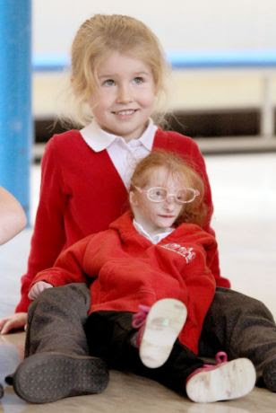 Smaller than her favourite teddy: Charlotte is just 68cm tall and weighs less than 9lbs