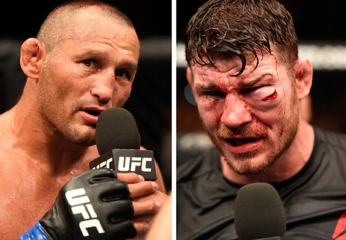 Dan Henderson e Bisping ao fim da luta: inglês ficou muito mais machucado (Foto: Getty Images)