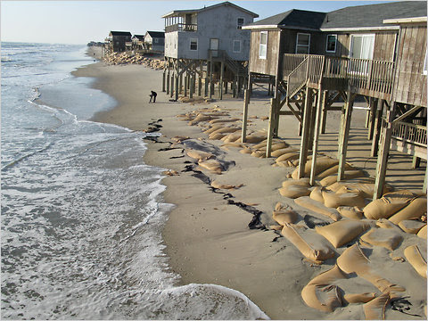 Sand bags protect homes from beach erosion in Nags Head, N.C.