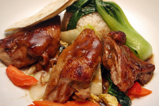 Asian-style duck with Hoisin glaze, served with rice, vegetables and Chinese pancakes