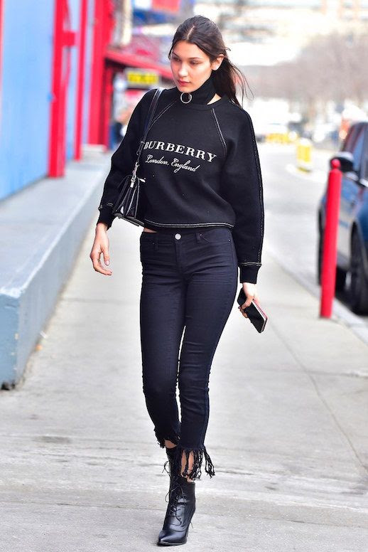 Le Fashion Blog Bella Hadid 90's Logo Hoodie Raw Hem Jeans Black Booties Via Vogue