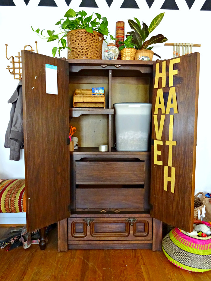 cabinet for hiding office and craft supplies