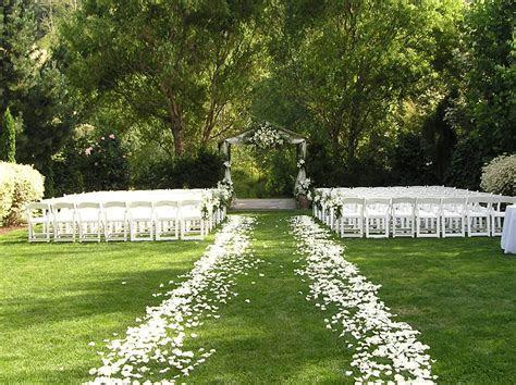 Gorgeous white rose petal ceremony aisle!   Elegant Garden