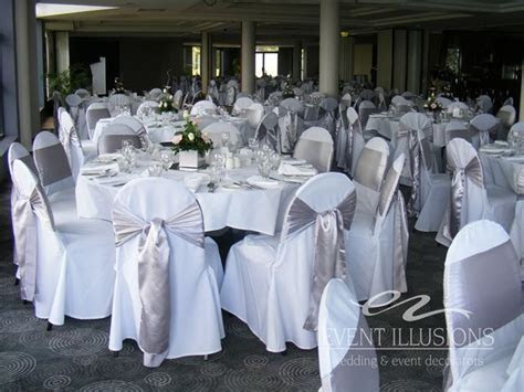 White chair covers with silver sashes used at Mandy and