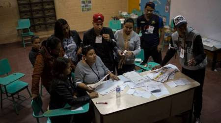 Honduras elections: officials to hand count final votes
