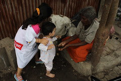 Marziya and Nerjis Giving Charity to the homeless lady of Bandra Reclamation by firoze shakir photographerno1