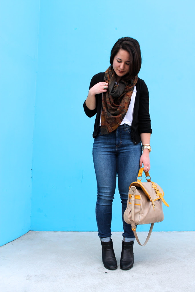 skinny jeans, boots, and a printed scarf