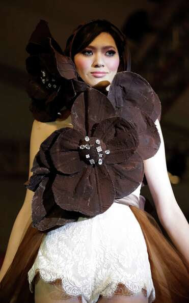 A model displays a dress partially made of chocolate during a chocolate fashion show in Shanghai.