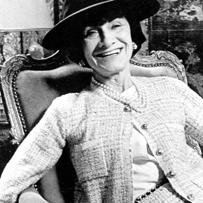 Coco Chanel in a tweed jacket