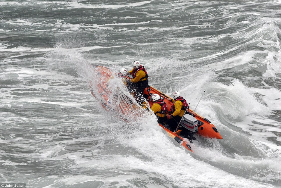 Heroic: John Julian's photograph shows a rescue boat crashing against rough water in St Agnes, Cornwall