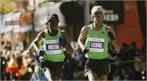 Geoffrey Mutai, left, of Kenya and Gebre Gebremariam led the men for the last part of the race. Gebremariam pulled away and won his first marathon.