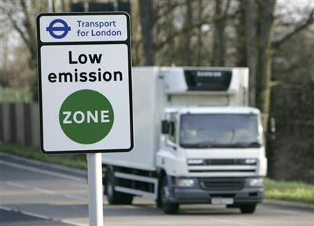 A vehicle passes a sign for the new Low Emissions Zone at Coulsdon in London February 3, 2008. (Credit: Reuters/Luke Macgregor) Click to enlarge.