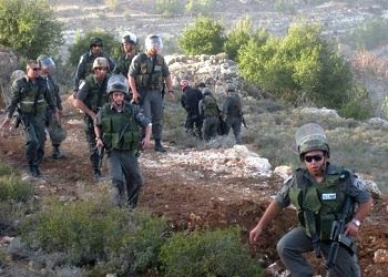 Professor Mazin Qumsiyeh and others were arrested for non violent protest against the destruction of Palestinian land by Israeli military bulldozers.
