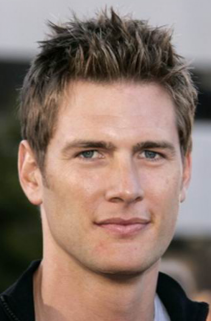 Mens 2013 layered short hairstyle with spiky bangs with a very short hair length.PNG