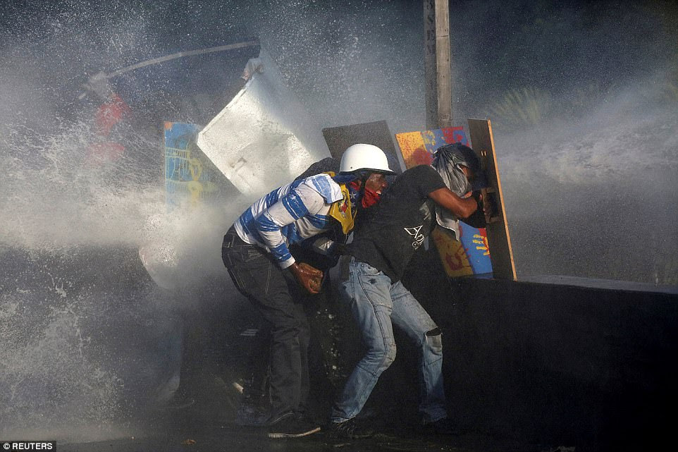Opposition supporters clash with riot security forces while rallying against President Nicolas Maduro in Caracas, Venezuela, May 18. Three days later more than 200,000 would march to mark the 50th day of protest against the country's leader, bringing the centre of the country's capital to a standstill