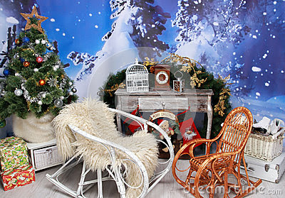 Cosy interior of Christmas decoration with pine tree and rocking