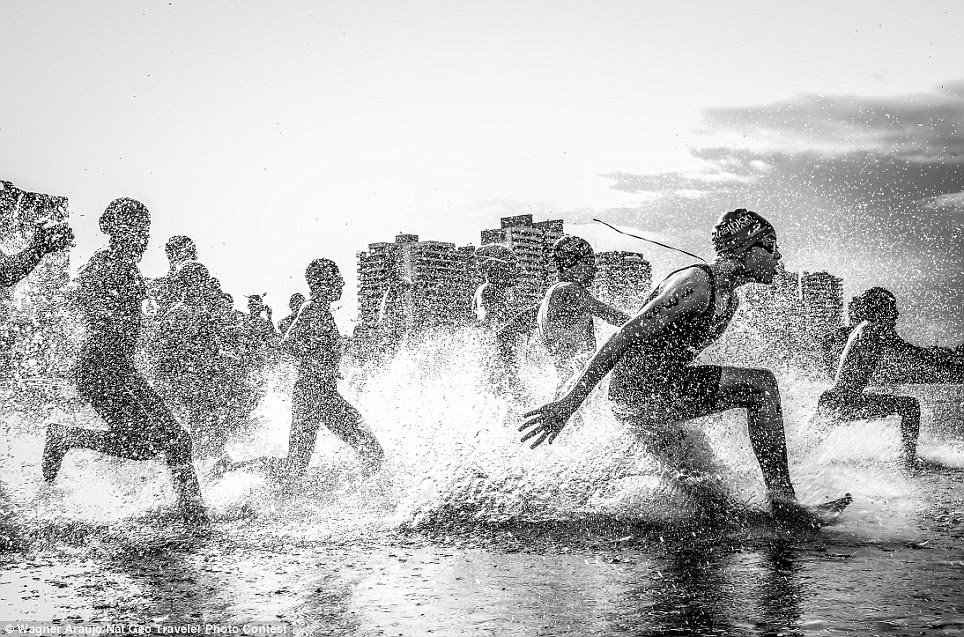 Money shot: The top prize went to photographer Wagner Araujo, who captured this incredible image while attending the Brazilian Aquathlon (swimming and running) championship in Manaus