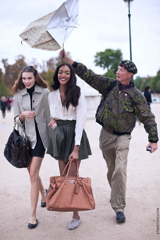 Its raining and Models smiling for Paris Fashion via The Vogue Diaries