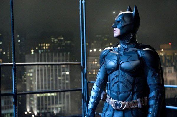 Batman (Christian Bale) stares at an unseen danger in THE DARK KNIGHT RISES.