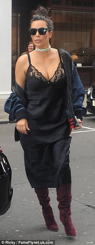 Lovely in lace: The Keeping Up With the Kardashians star put her ample assets on full display in the lingerie inspired piece which boasted a low-cut neckline and racy lace inserts around the bust
