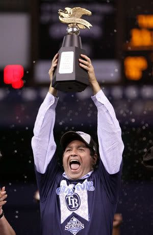 Principal owner of the Tampa Bay Rays, Stuart Sternberg celebrates with the American League Champion's trophy after defeating the Boston Red Sox in game seven of the American League Championship Series during the 2008 MLB playoffs on October 19, 2008 at Tropicana Field in St Petersburg, Florida. The Rays defeated the Red Sox 3-1 to win the series 4-3.