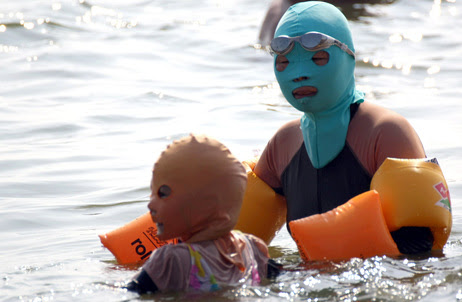 Chinese swimmers wear face-kinis at the public Huiquan Beach in Qingdao, on China's eastern coast.