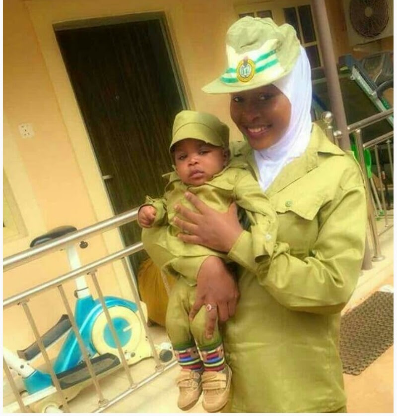 Female Corper And Her Child Rocks NYSC Kaki, Its So Adorable (photos)