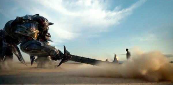 Megatron swings his sword at a human in TRANSFORMERS: THE LAST KNIGHT.