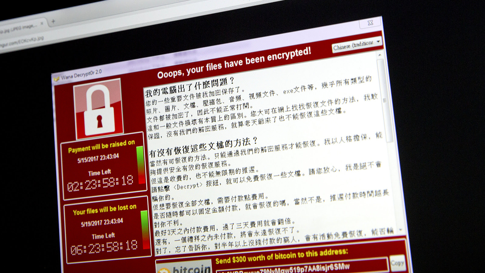 A screenshot of the warning screen from a purported ransomware attack, as captured by a computer user in Taiwan, is seen on laptop in Beijing, Saturday, May 13, 201. (AP/Mark Schiefelbein)