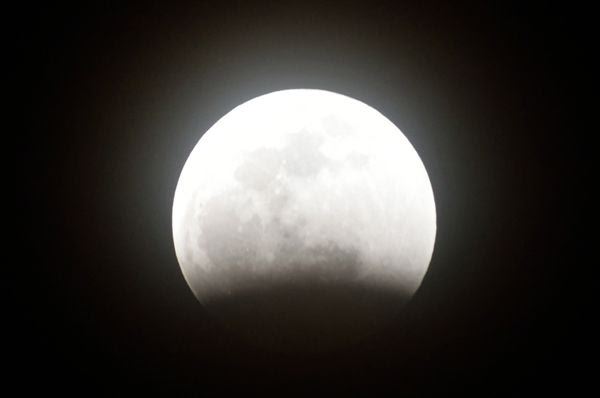 Earth's shadow slowly creeps along the lunar surface...leading up to the Super Blood Wolf Moon lunar eclipse on January 20, 2019.