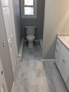 Gray Plank Tile Bathroom | First Class Remodeling