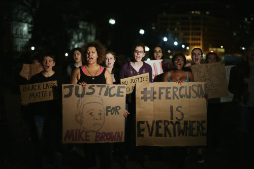 Demonstrators march outside the White House on Monday night. (Chip Somodevilla/Getty Images)