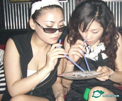It's a picture of 2 girls 'being bad' with washing powder on a plate. Great.