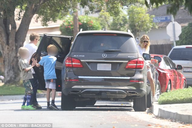 Family time: Roberts was out and about with her cameraman hubby Danny Moder, 48, and their 12-year-old twins Hazel and Phinnaeus