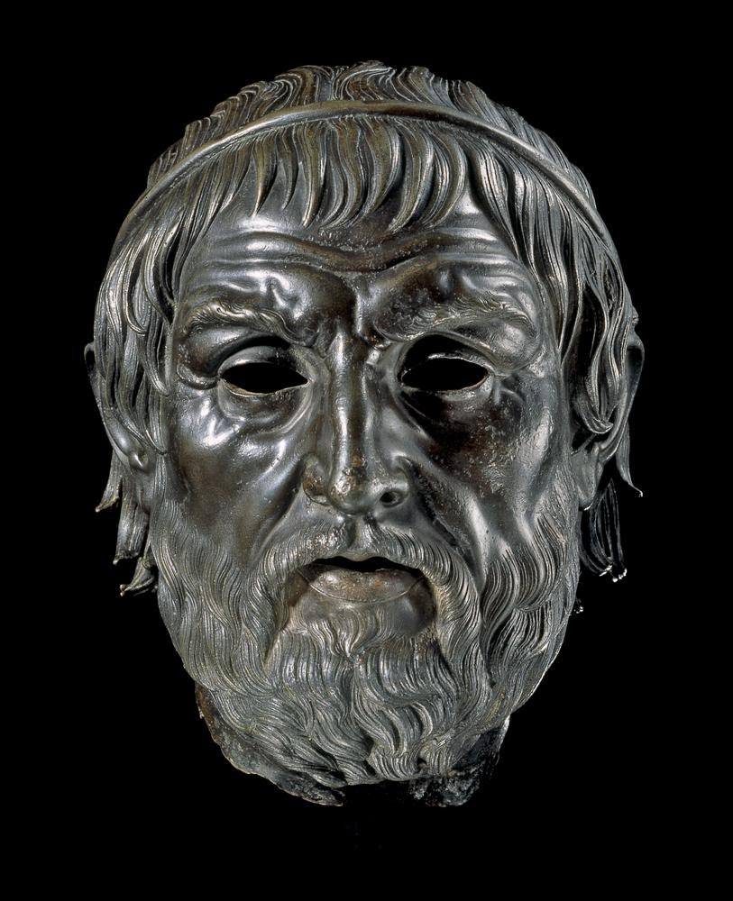 Bronze head from a statue, perhaps of Sophocles. This head represents a man of middle age, with a thick beard, slightly thinning hair and a severe expression, enhanced by a deeply wrinkled brow. His hair is bound by a rolled band, like a diadem of a type usually associated with Hellenistic rulers, rather than philosophers or playwrights. The body types for statues of famous intellectuals are generally semi-draped, with perhaps only the chest bared. Both the body and the face usually exhibit signs of age.