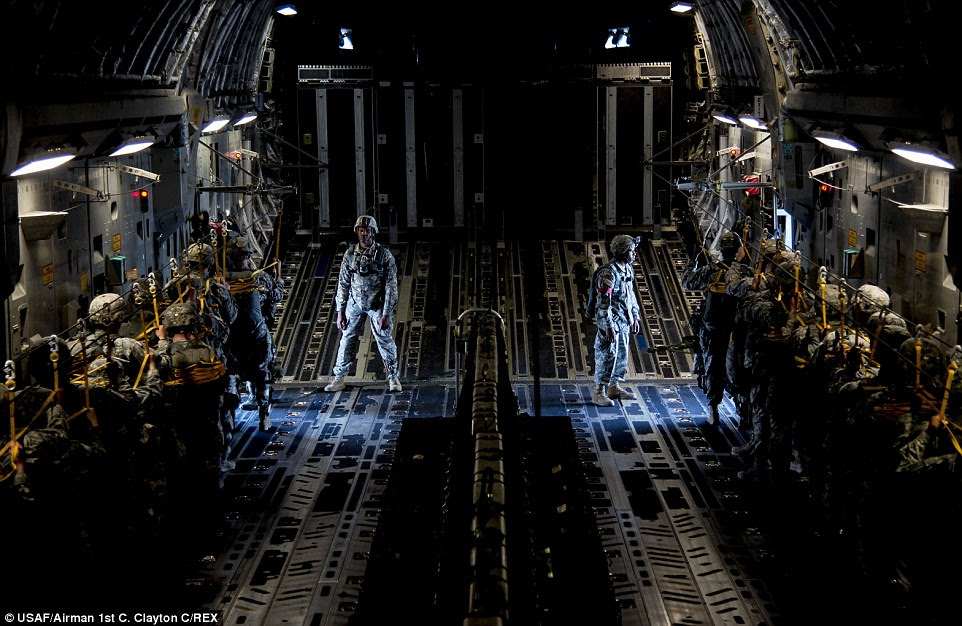 Jump: Paratroopers on a C-17 Globemaster III await instructions to jump from the aircraft. The Soldiers, assigned to the 82nd Airborne Division at Ft. Bragg, N.C., were part of a large formation exercise that provided more than 500 operational and maintenance training objectives