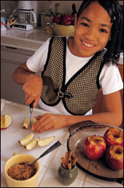 Young girl slicing an apple