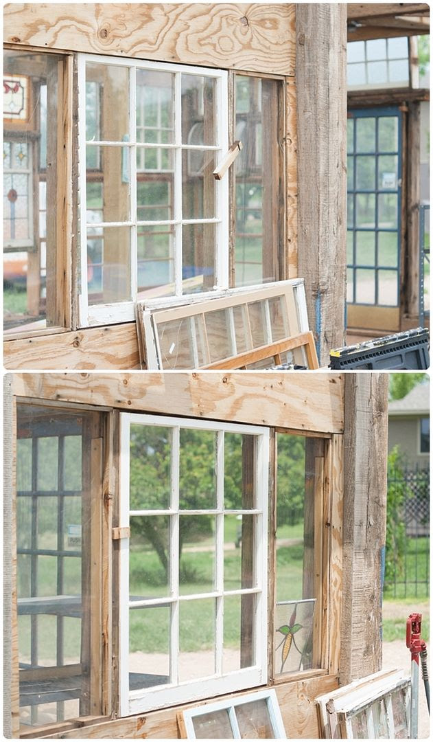 upcycled greenhouse made from reclaimed wood, vintage windows and doors
